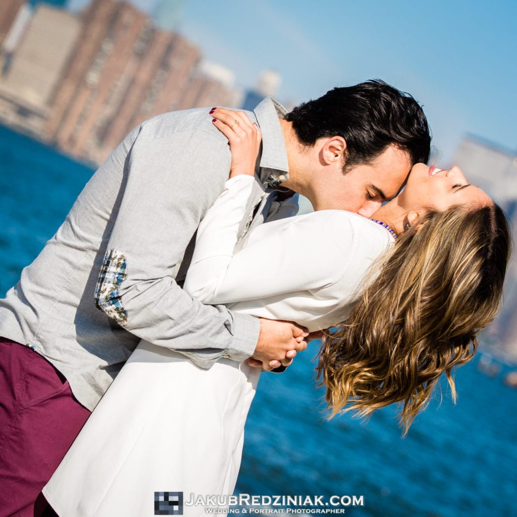 Couple Engagement Session by the East River Kissing in Brooklyn, NY