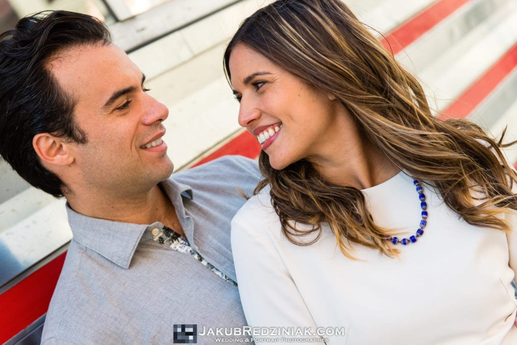 good looking couple happy posing during engagement session in williamsburg, ny