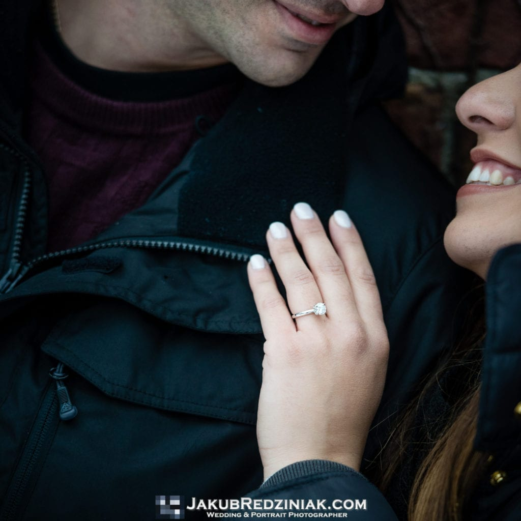 engagement ring closeup of couple in central park