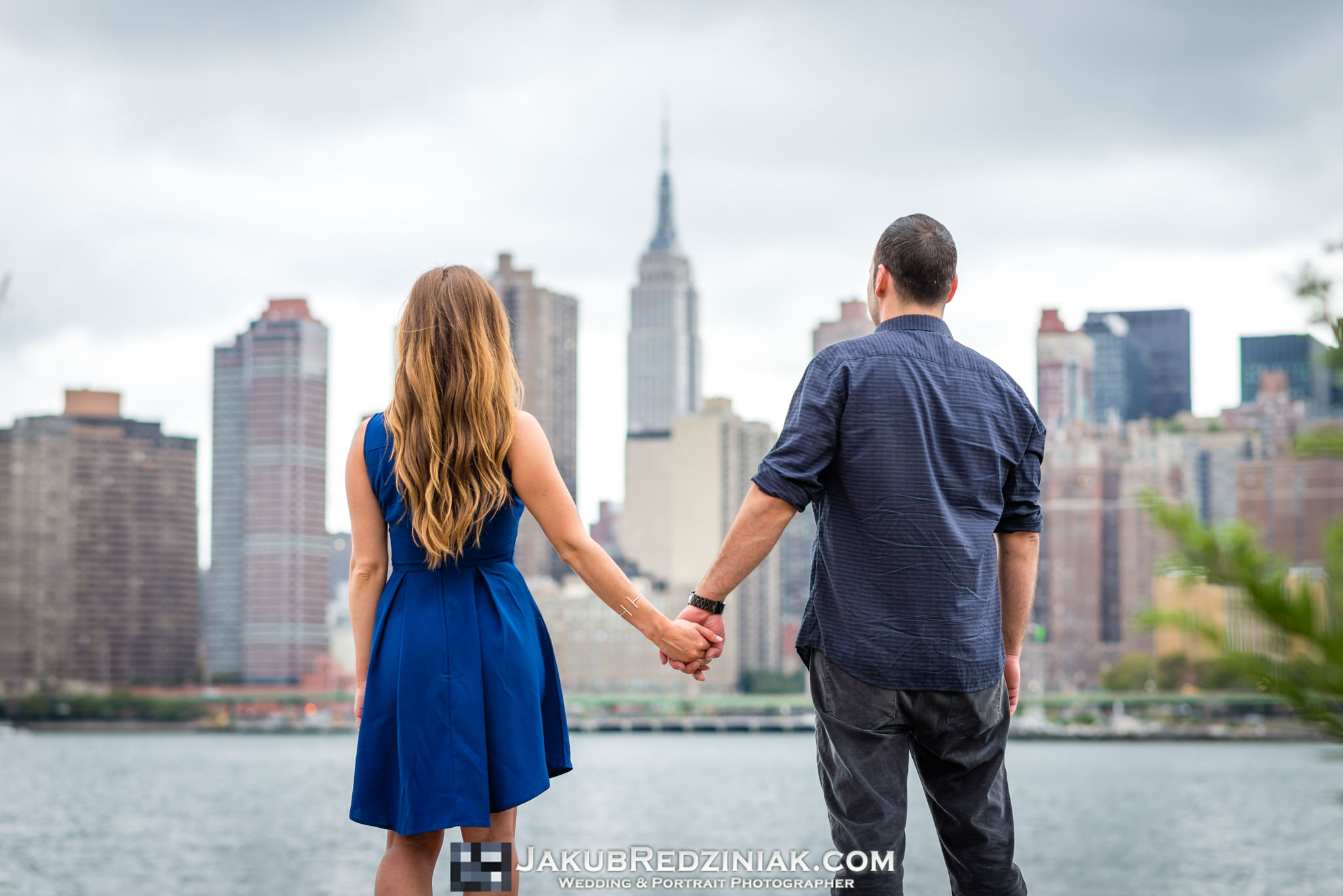 couple holding hands with nyc skyline
