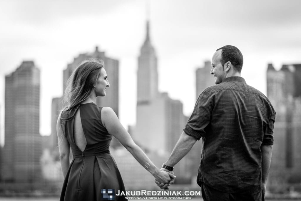 couple holding hands with nyc skyline black and white