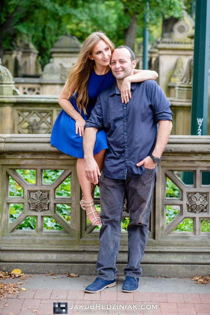 couple engagement session in central park on autumn day next to bethesda terrace