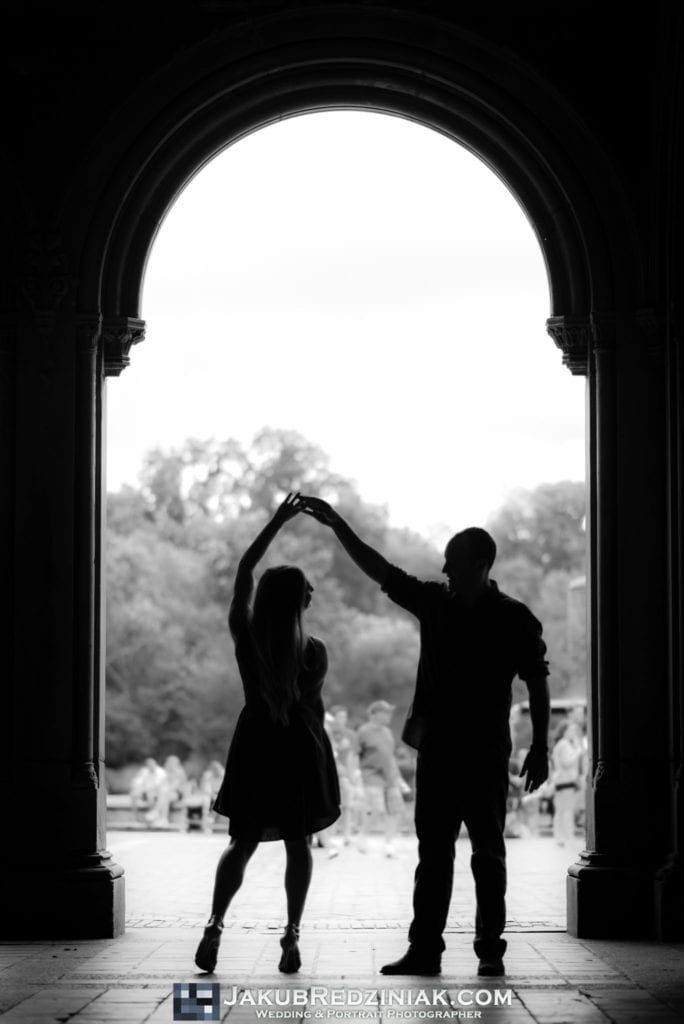 couple engagement session dancing sillouette black and white under bethesda terrace in central park new york city