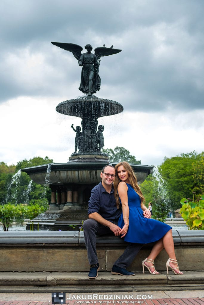 couple engagement session sitting on bethesda fountain in central park new york city