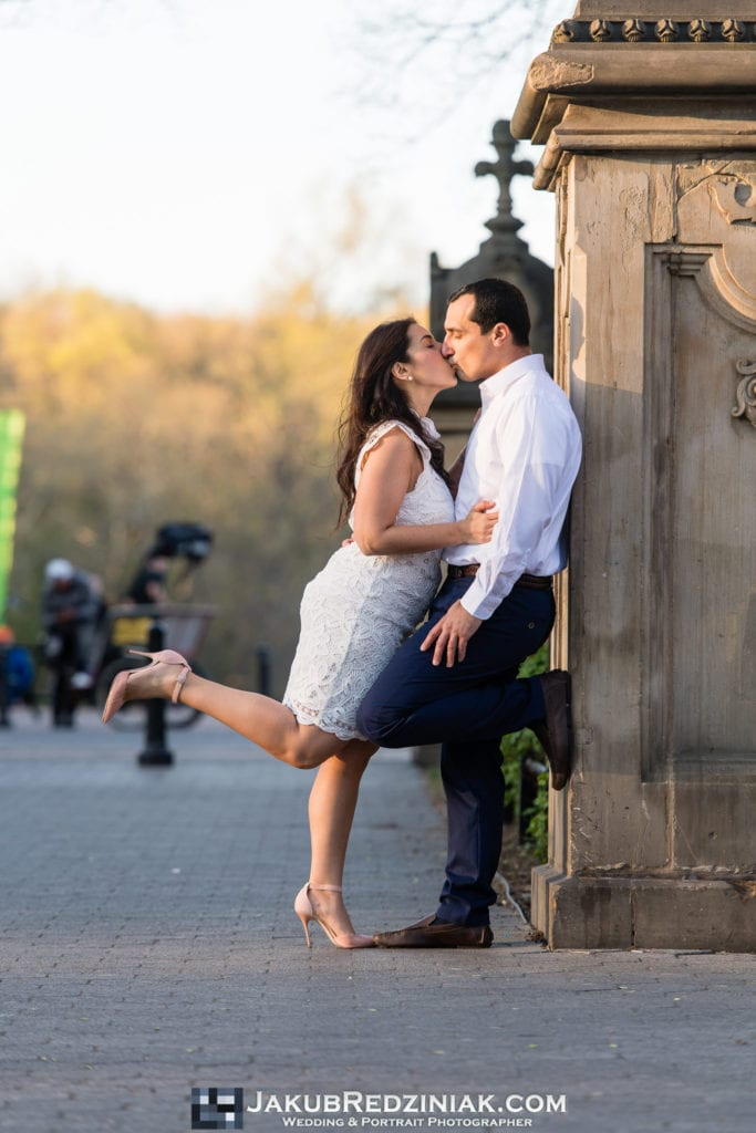 engagement session couple in central park kissing at bethesda terrace
