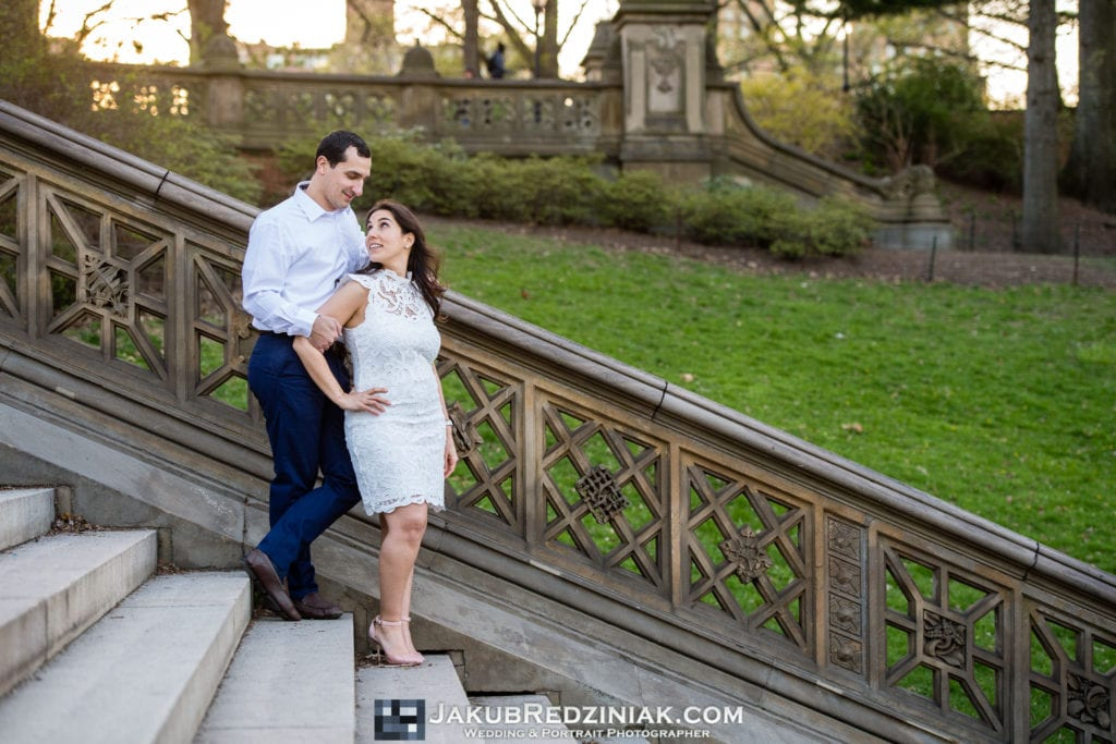 engagement session couple in central park walking down steps at bethesda terrace
