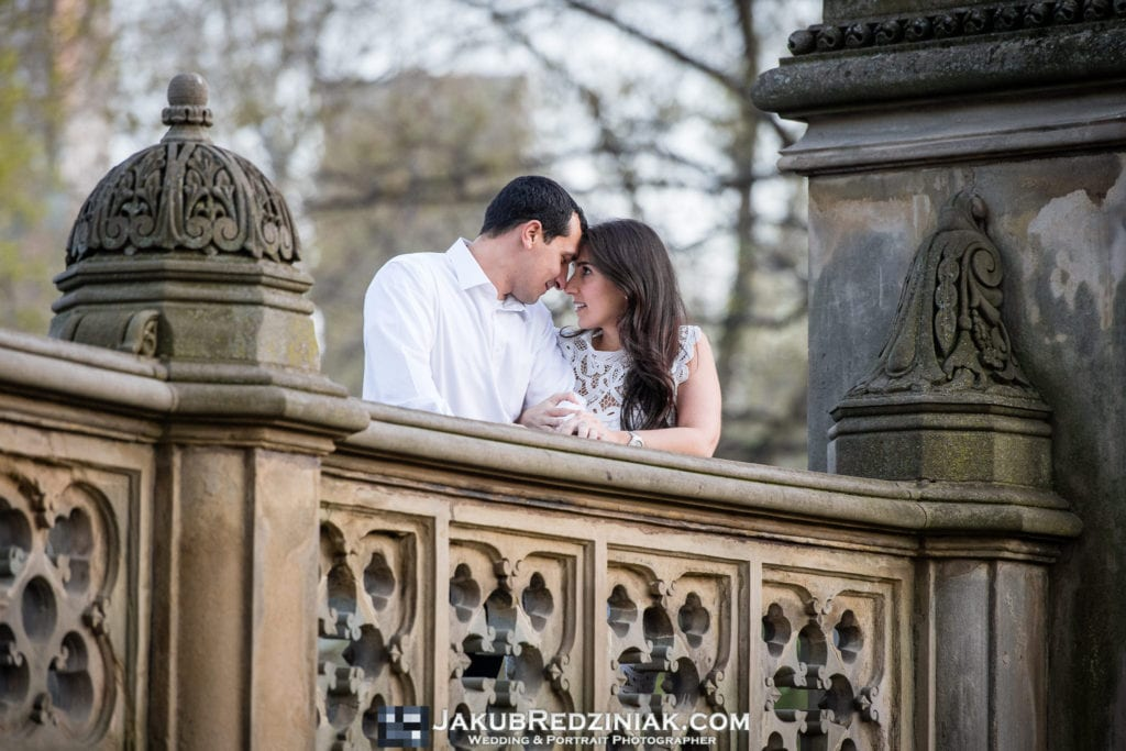 engagement session couple in central park kissing on bethesda terrace in new york city