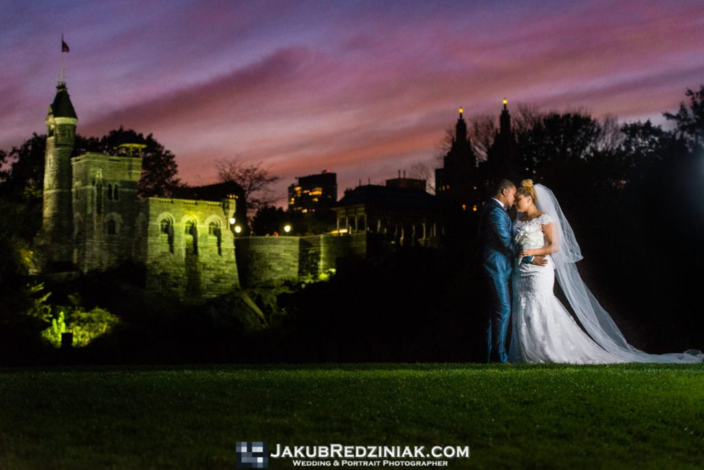couple wedding photo at belvedere castle night photo sunset with purple sky and creative lighting