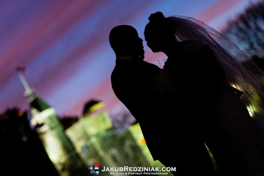 couple wedding photo at belvedere castle night photo sunset with purple sky silhouette