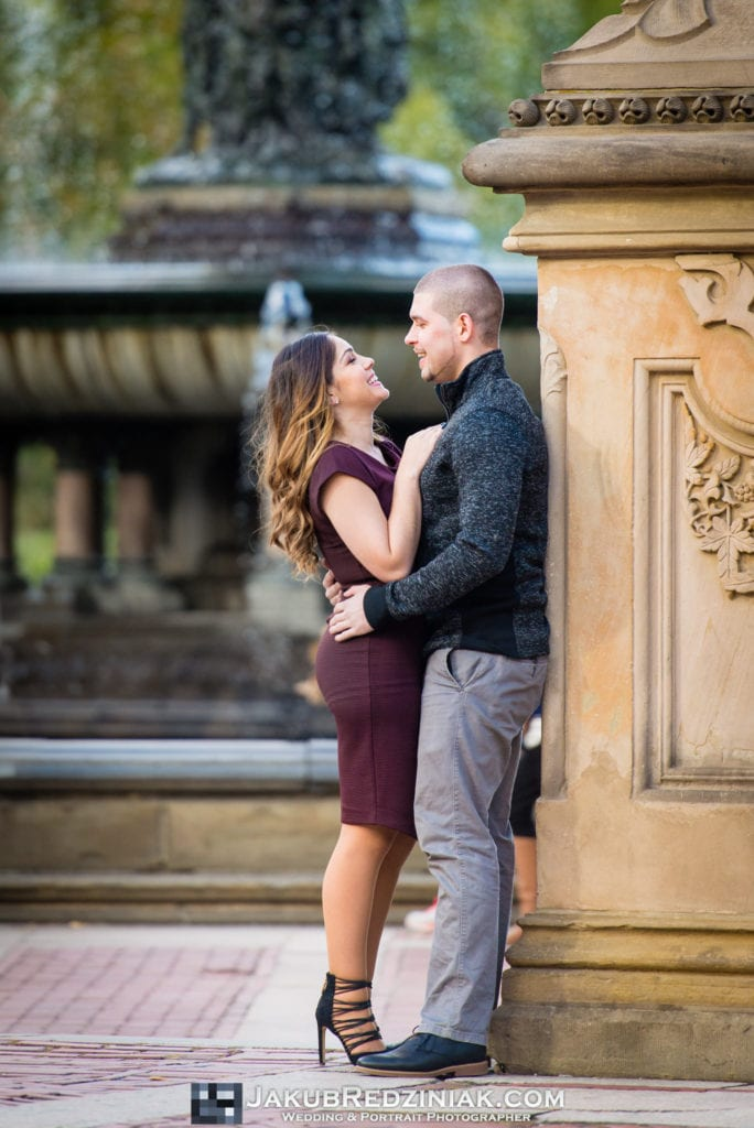 couple posing and happy in front of bethesda fountain in central park new york city