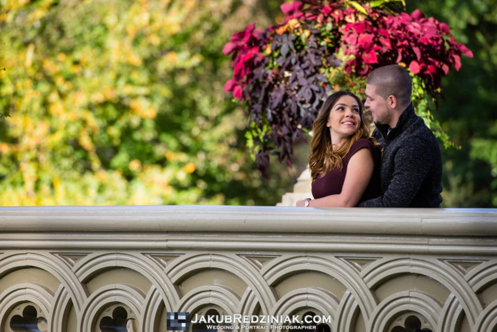 couple engagement session on bow bridge in central park new york city