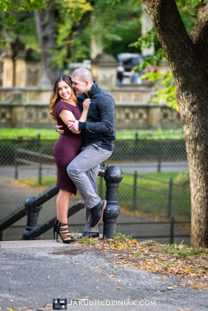 couple pose in engagement session next to bethesda terrace