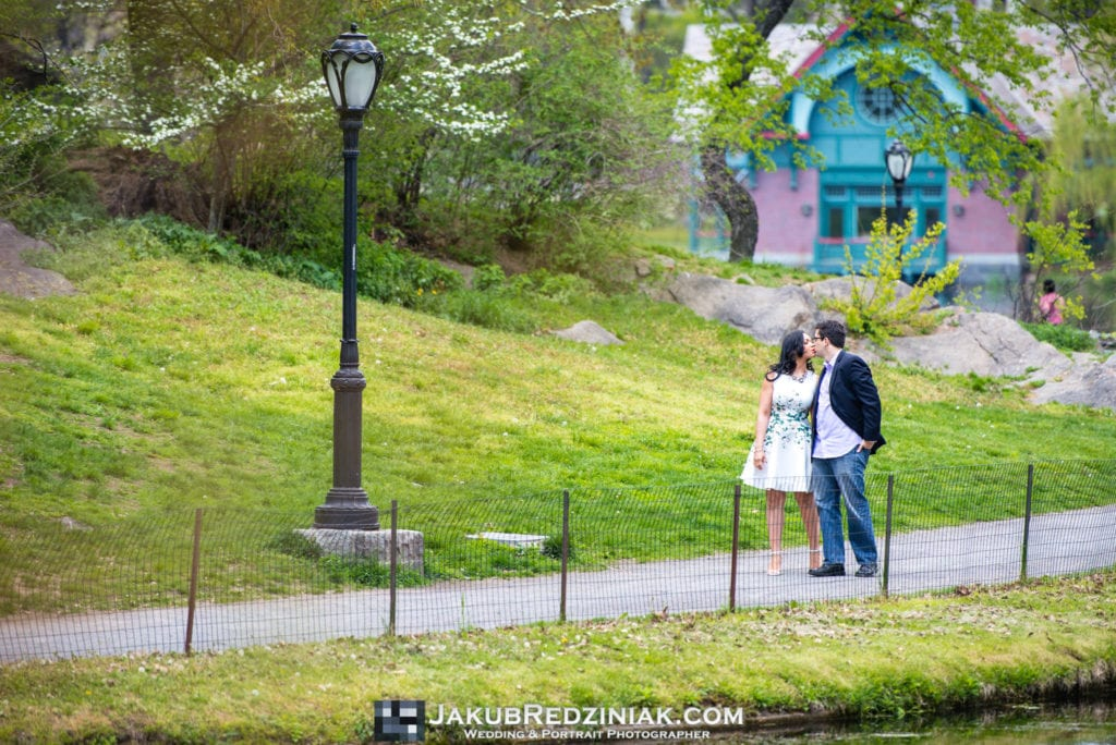 Couple posing in Conservatory Gardens Central Park in New York City for engagement session by harlem meer