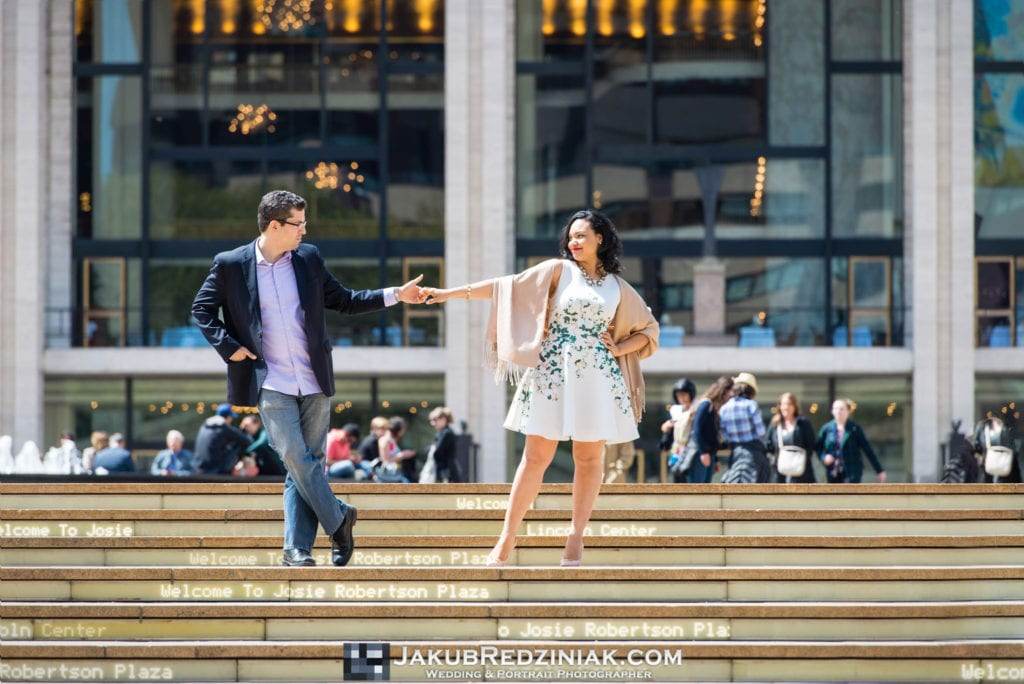 couple dancing on steps of lincoln center for engagement center in new york city