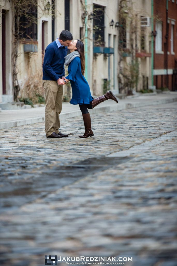 couple kissing in washington mews by nyu in new york city for engagement session after proposal