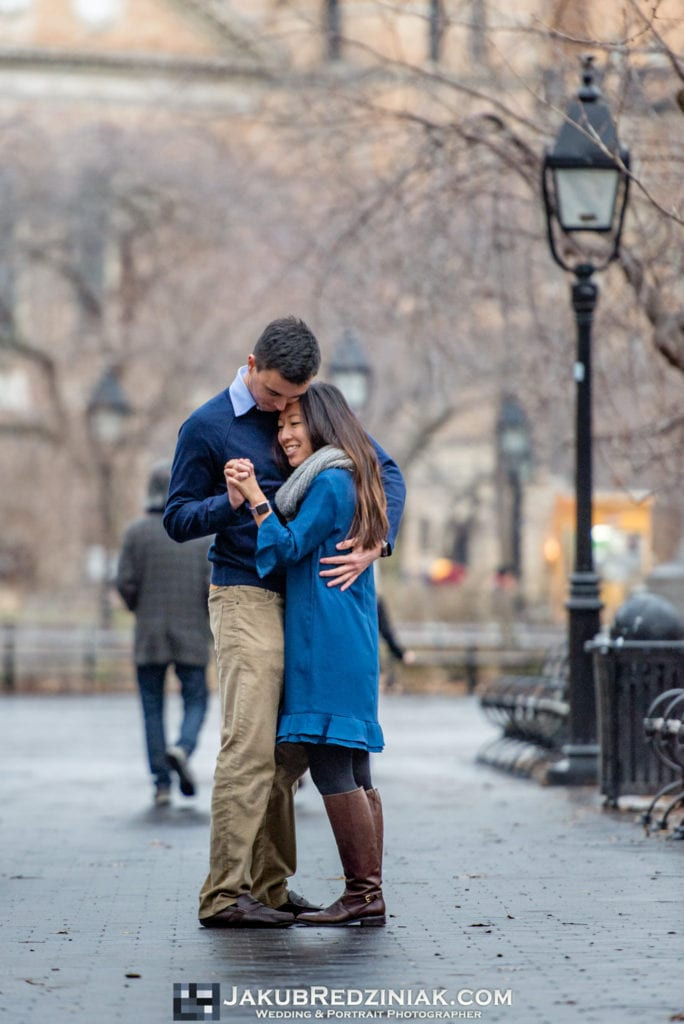 couple happy together engagement session after proposal in new york city by washington square park