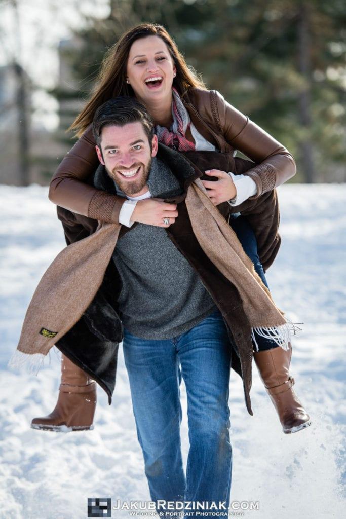 central park engagement session after proposal girl piggyback riding man fun creative pose