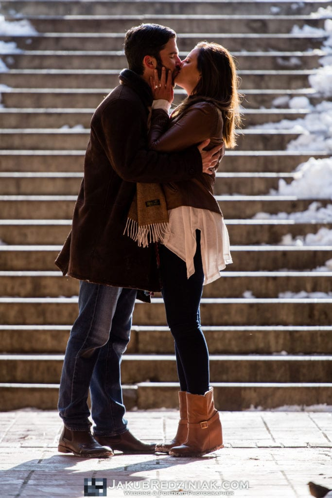 central park engagement session after proposal in the snow couple standing under bethesda terrace