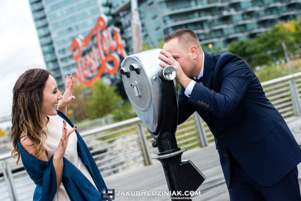 Elopement photo session in new york city at gantry plaza state park in long island city by the east river with couple by pepsi cola sign creative pose