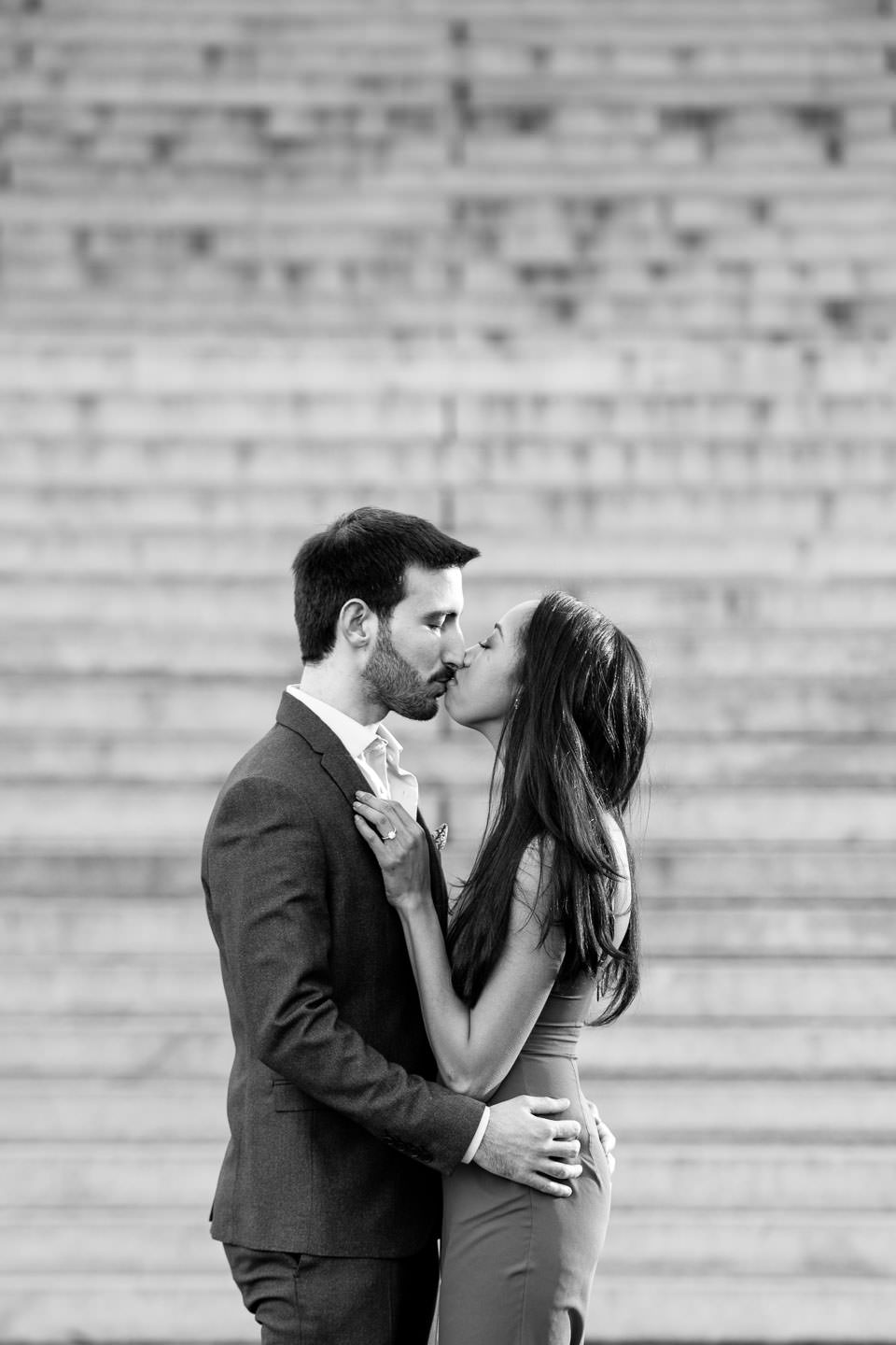 couple standing on steps by bethesda terrace and fountain for engagement session