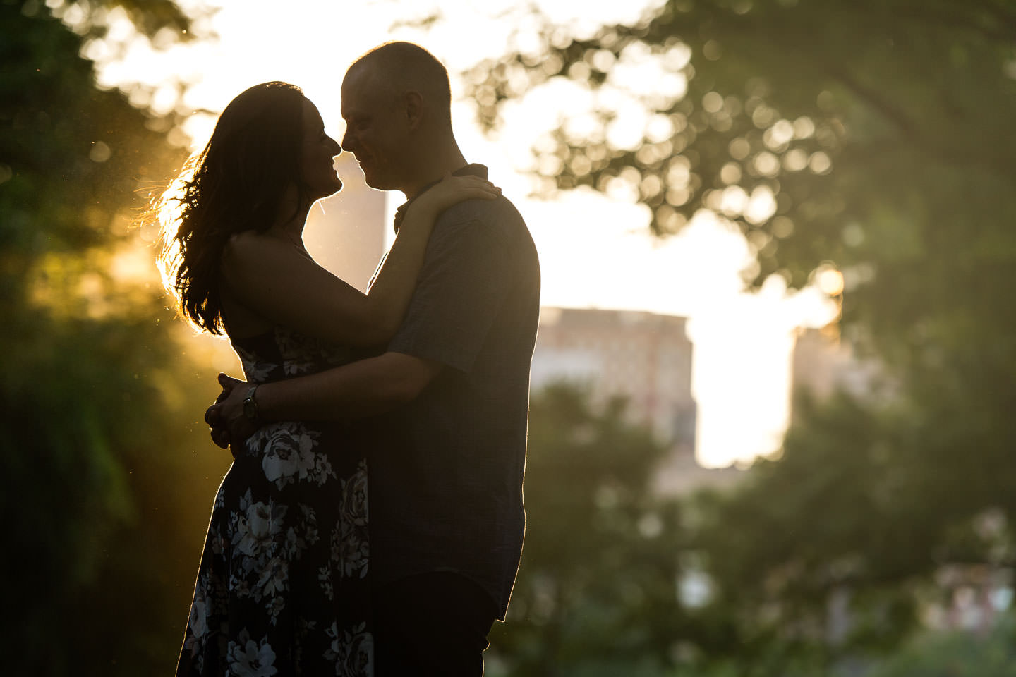 engagement session with couple backlit by sun in central park new york city
