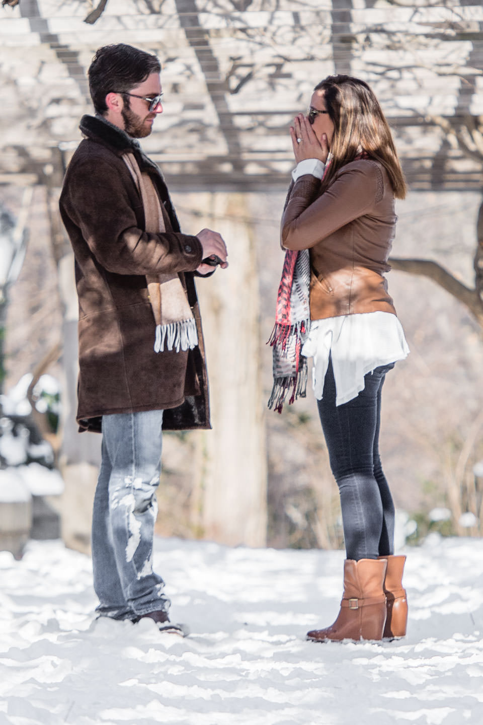winter proposal in central park with snow girl said yes
