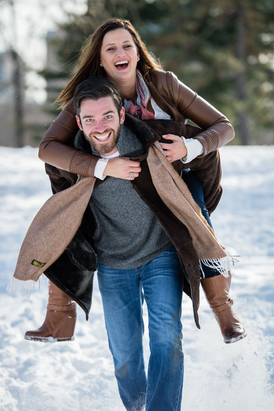 girl jumped on guys shoulders after proposal during engagement session happy she said yes