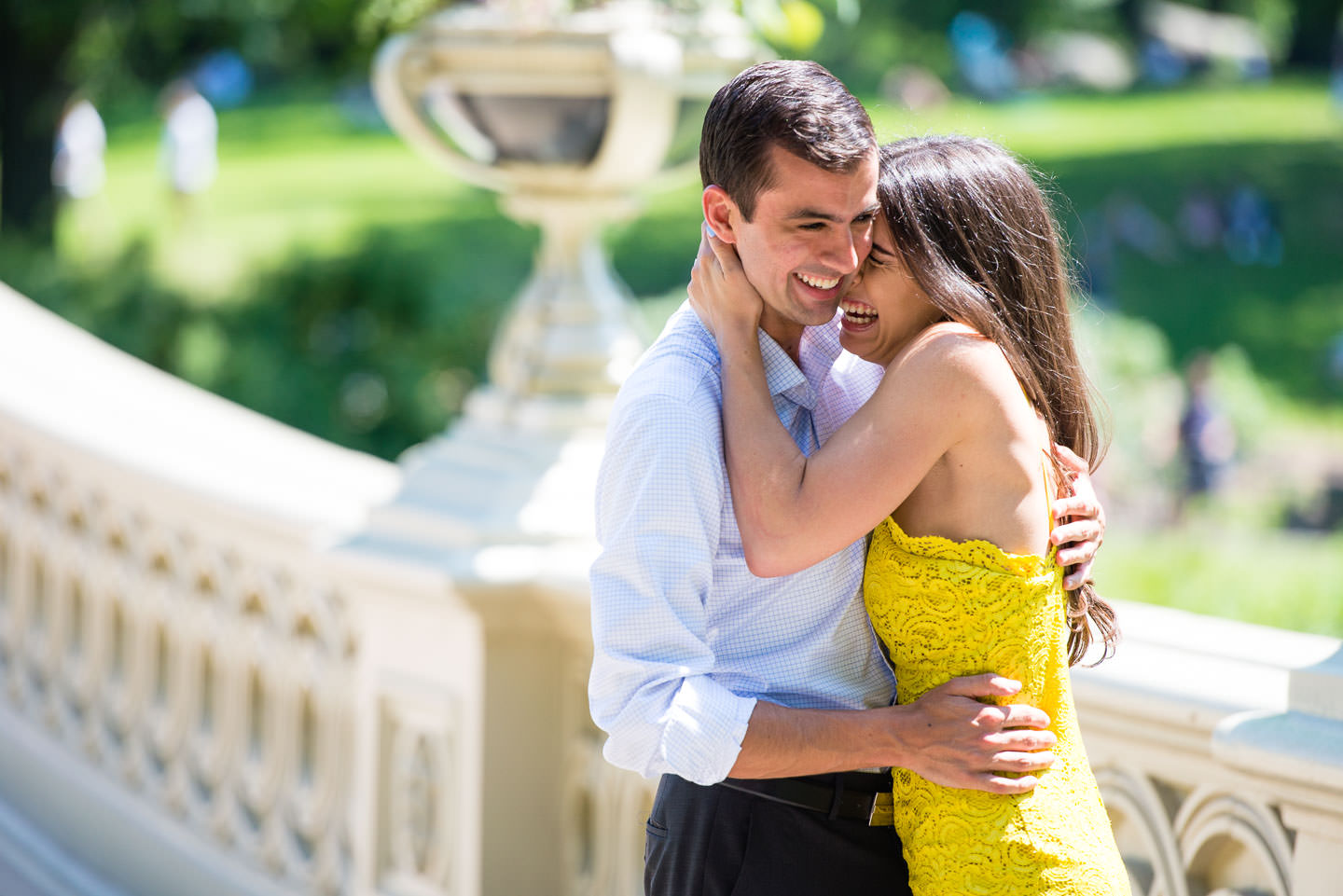 emotional girl happy after proposal on bow bridge in central park new york city