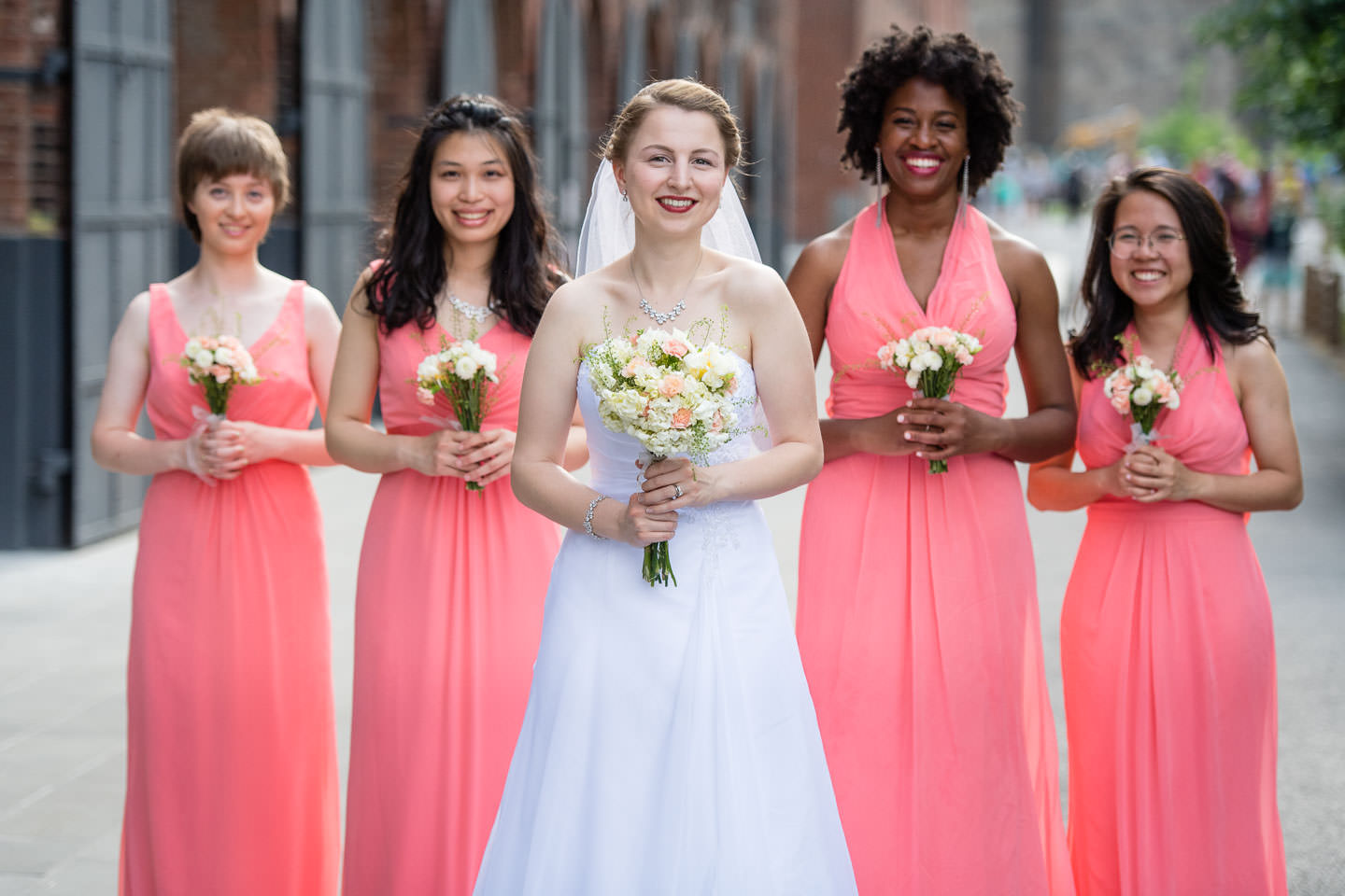 bride and bridesmaids in brooklyn bridge park in dumbo brooklyn new york city