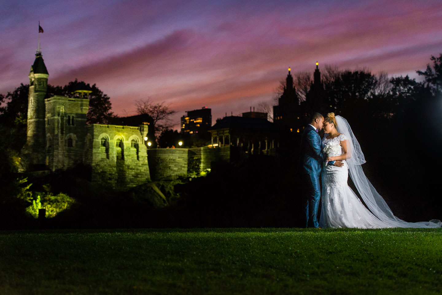 bride and groom wedding day in central park at belvedere castle at sunset