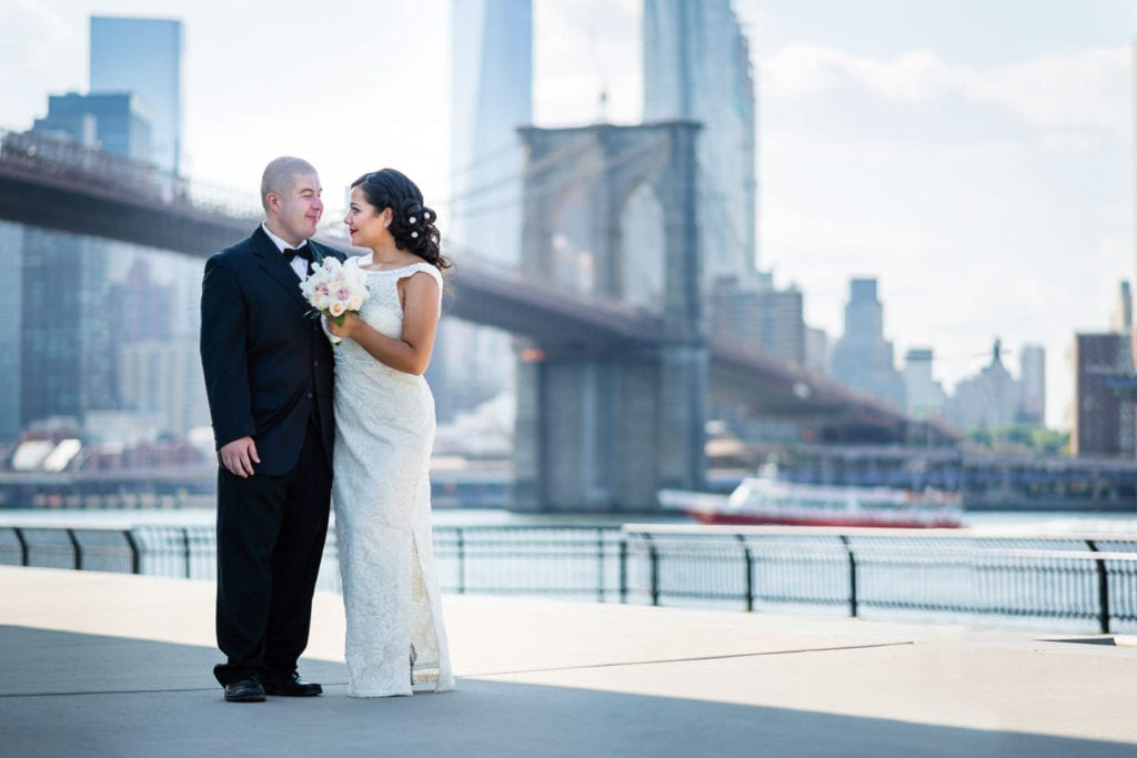 bride and groom with brooklyn bridge in dumbo brooklyn bridge park