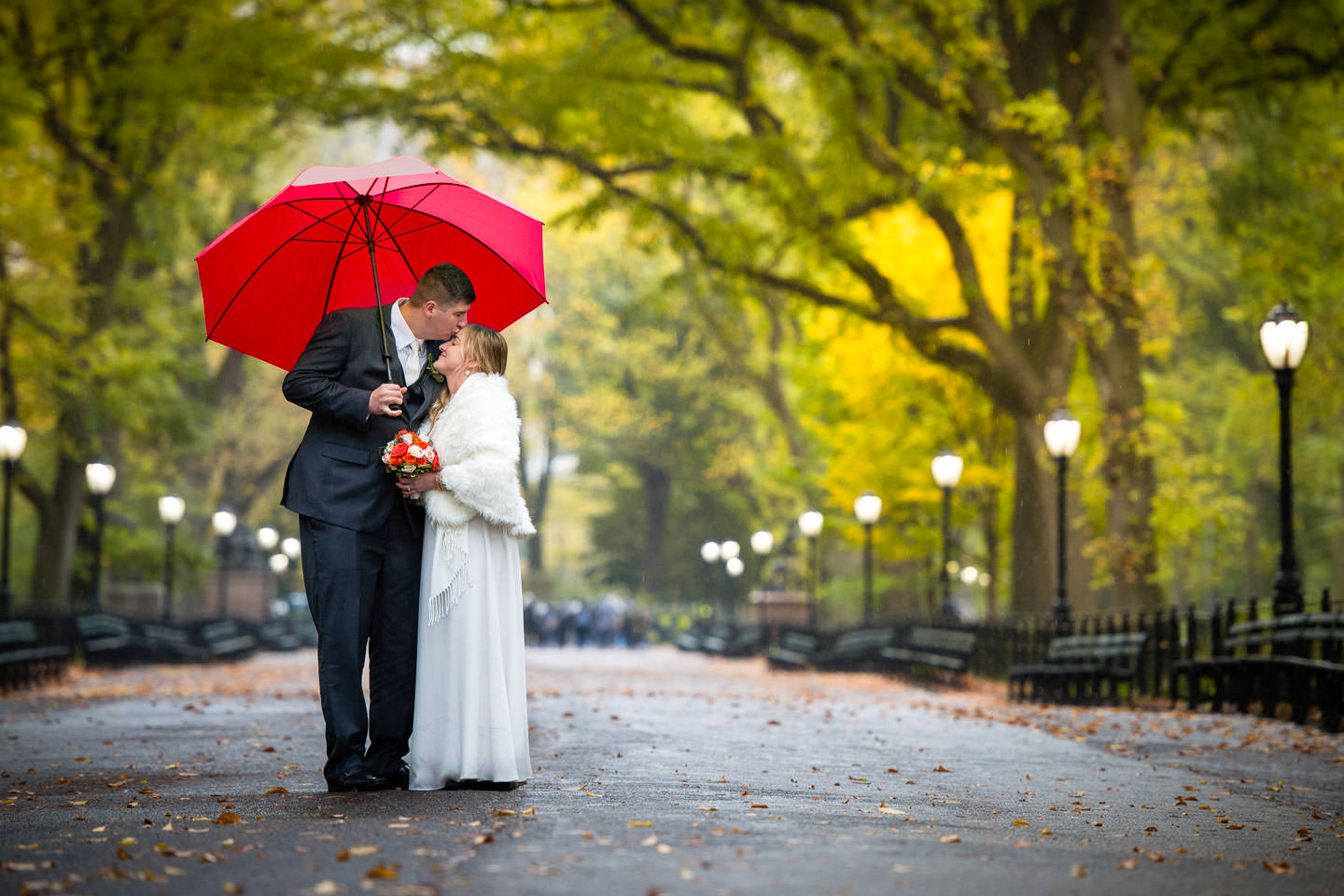 bride and groom in central park fall wedding session orange and yellow trees with no people