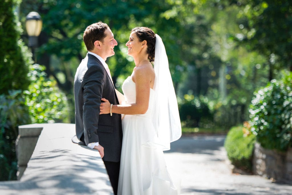 bride and groom in Carl Schurz Park upper east side new york for wedding photo session in the summer in rk bridal gown