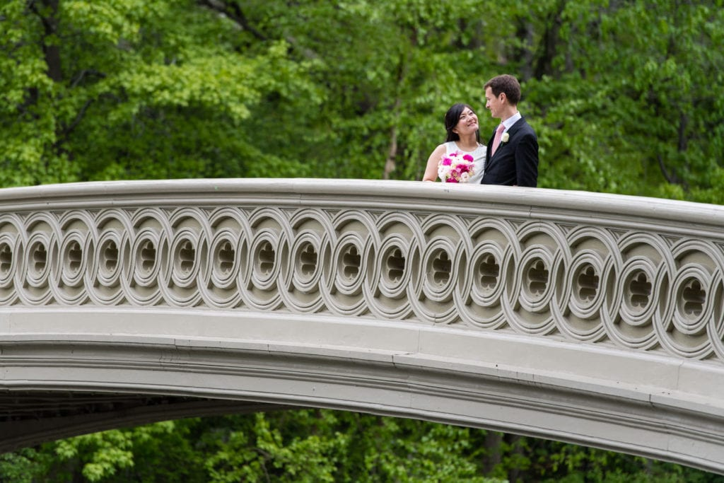 bride and groom on bow bridge in central park after elopement in new york city wed in central park