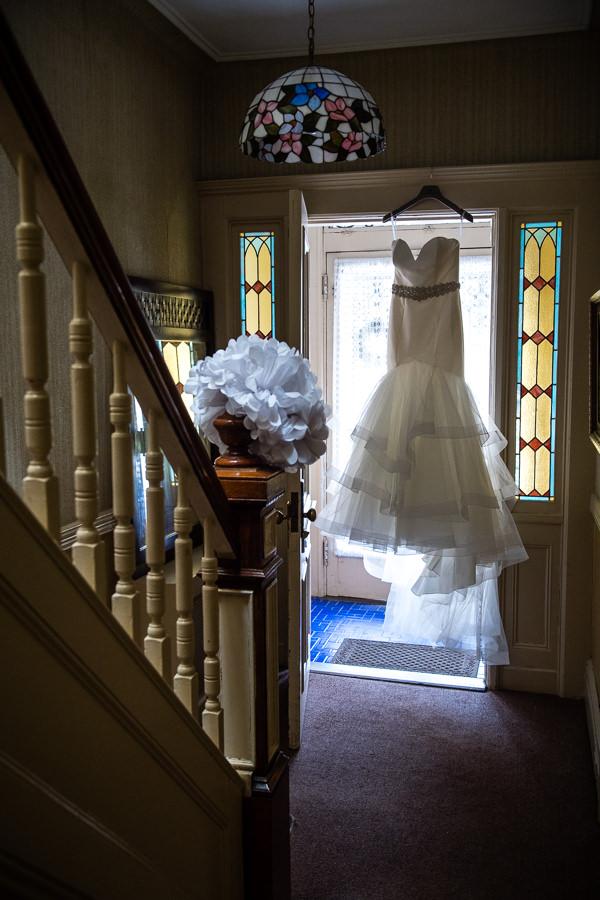dress hanging in hallway in ridgewood apartment in queens