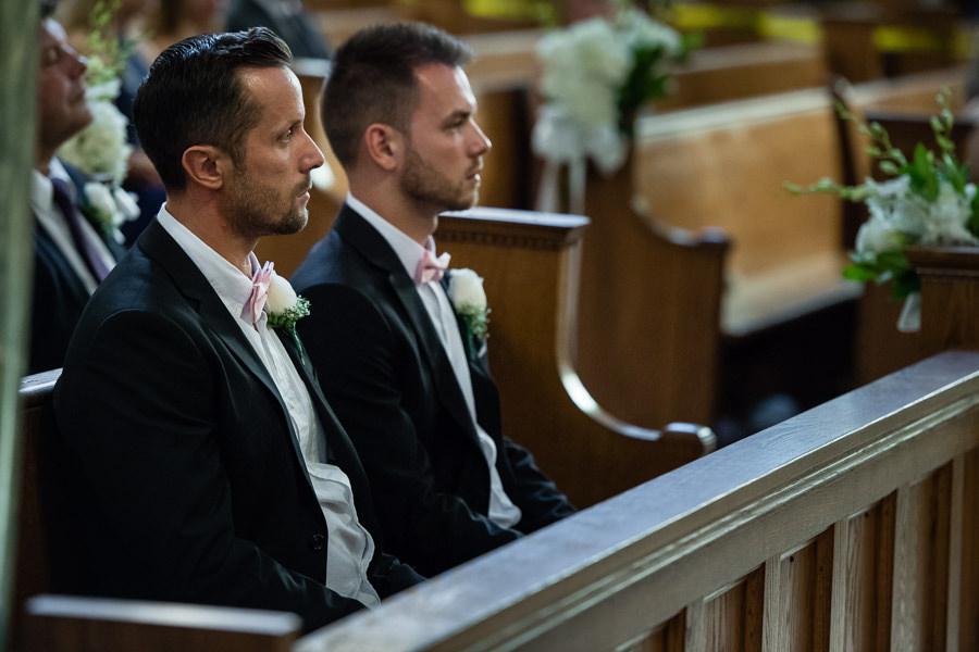 groomsmen sitting in church