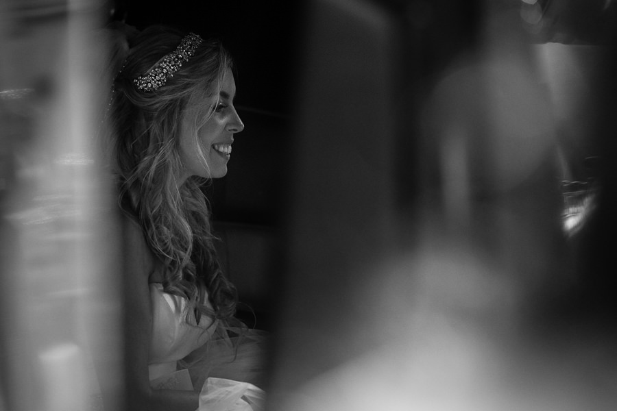 bride laughing in limo outside of romanoff restaurant