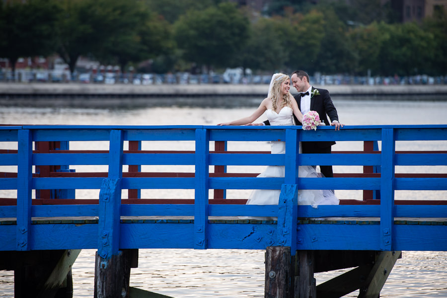 bride and groom photo session in sheepshead bay on a blue bridge