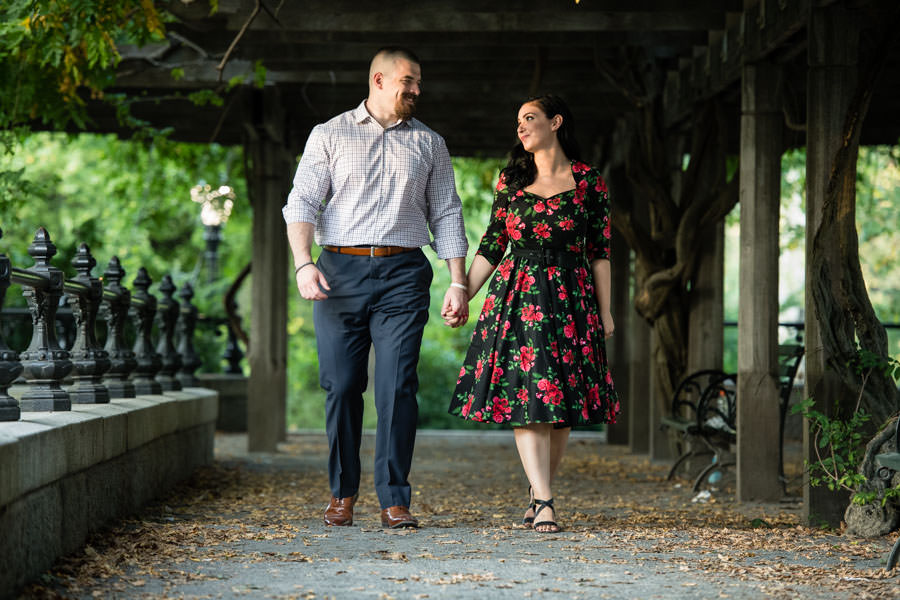 couple walking in central park after proposal