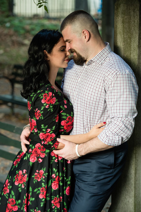 couple kissing in central park during their engagement session in nyc