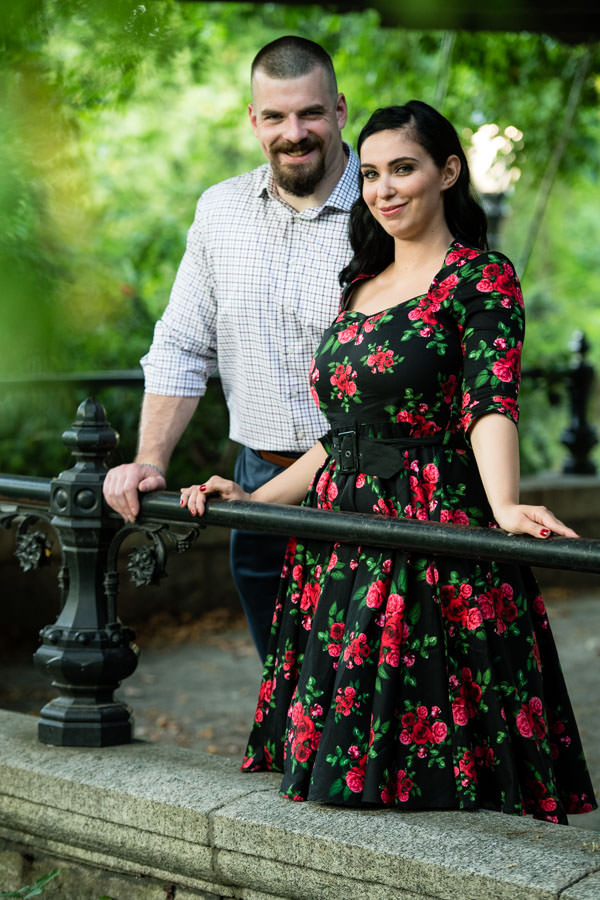 guy standing behind his fiance during engagement session in central park
