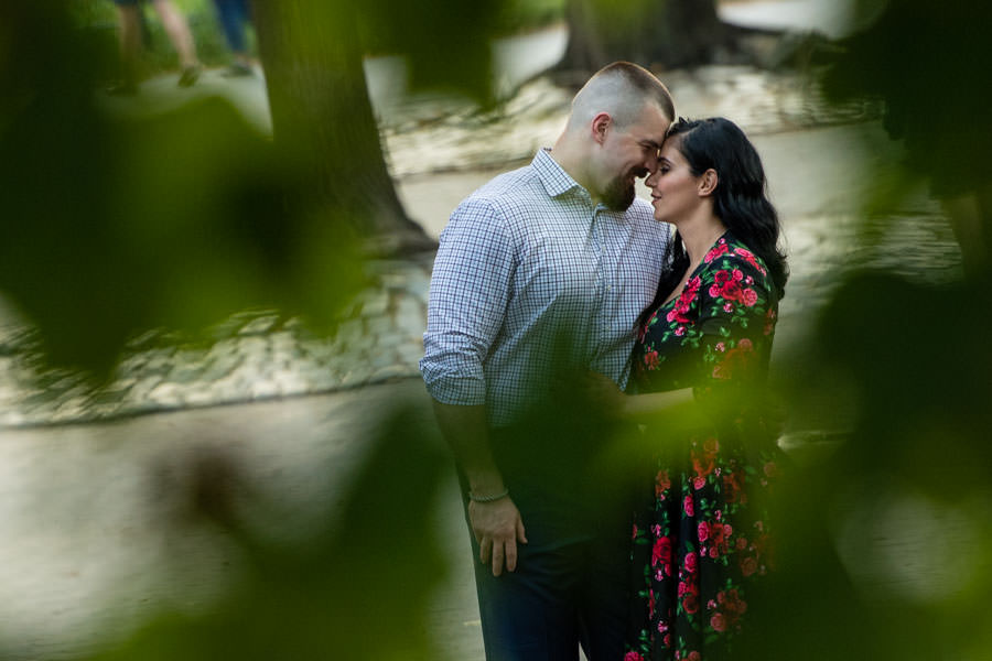 creative pose of couple kissing in central park