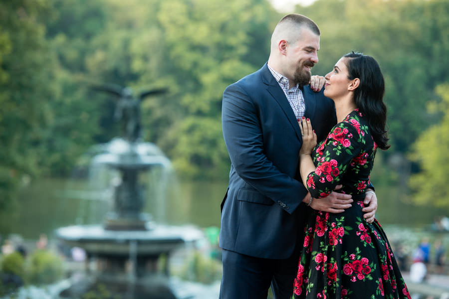 couple standing with bethesda fountain in the background