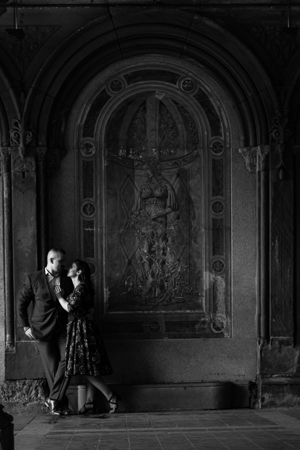 dramatic photo under bethesda terrace in central park during engagement session