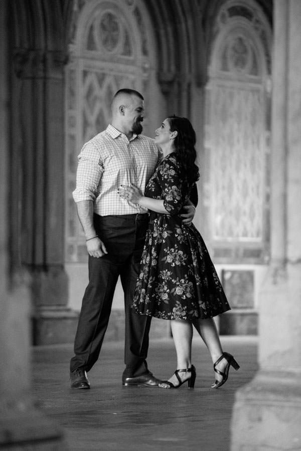 couple posing under bethesda terrace creative pose
