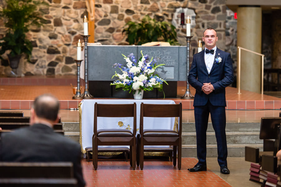 groom waiting for bride in church