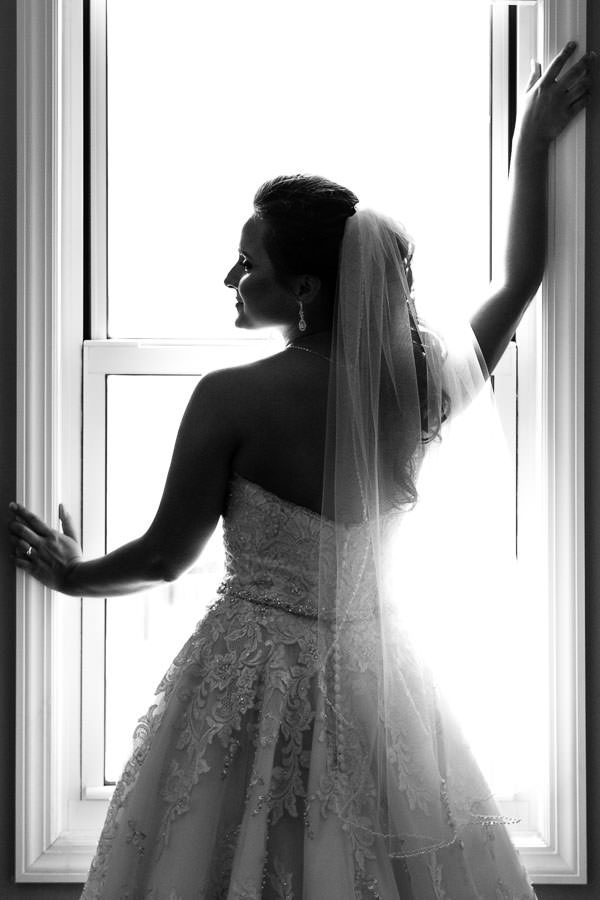 beautiful bride by window silhouette artistic photo