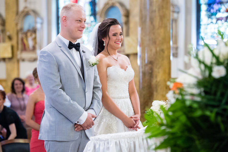 bride and groom during ceremony in st aloysius church ridgewood ny