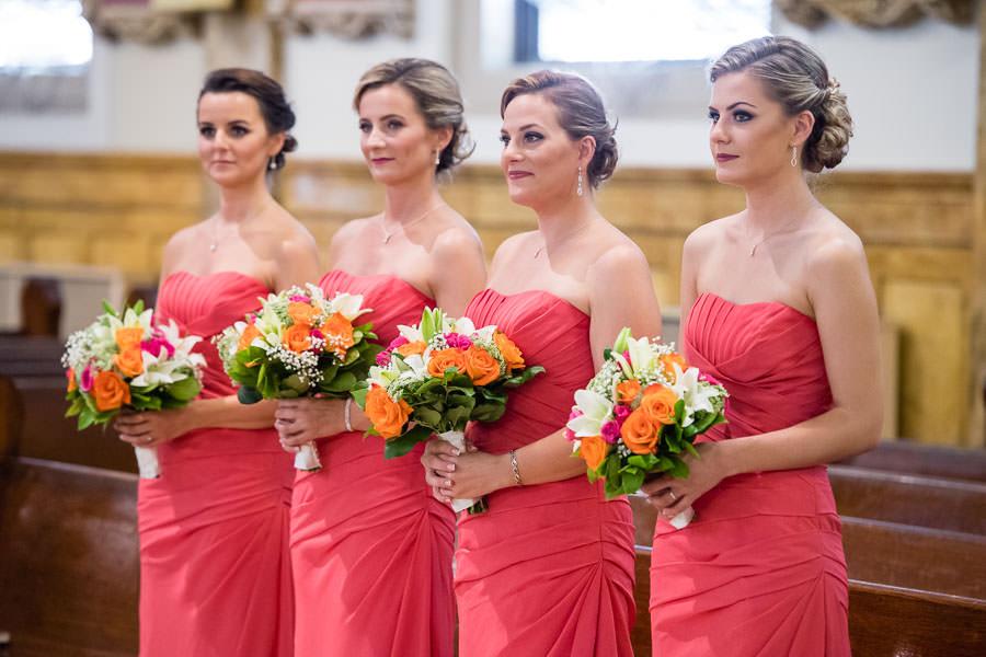 bridesmaids during ceremony in st aloysius church ridgewood ny