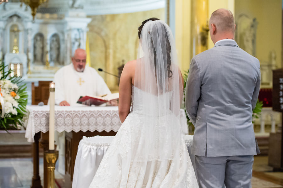 bride and groom at alter in church during wedding